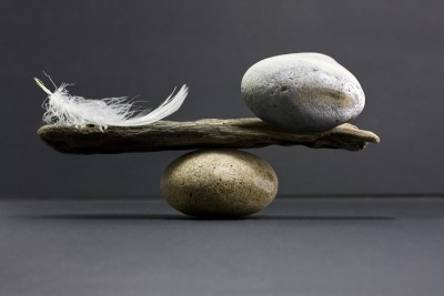 balancing rock and feather