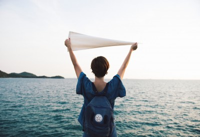 woman holding up a flag