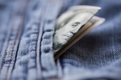 dollar money in pocket of denim jacket