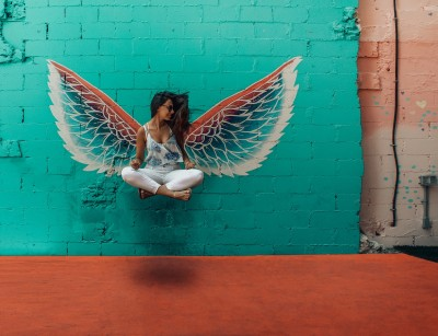 raise your vibration angel wings on wall